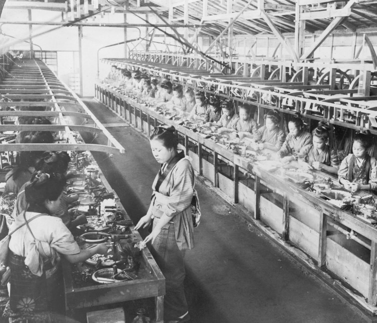 A Japanese silk factory in 1905. Work in progress larvae cocoons are being boiled and silk reeled onto spools
